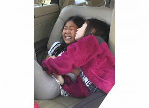 f and JJ car kissing